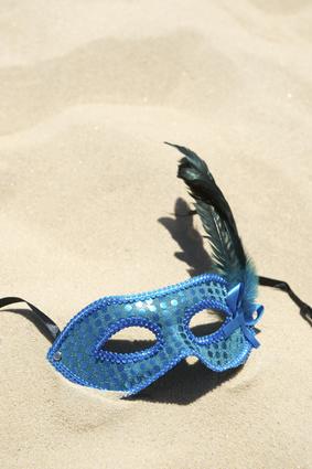 Carnival Mask on Sand Beach